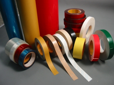 blue red silver green yellow brown coloured adhesive tapes of different sizes