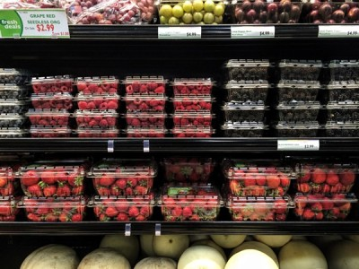 berries stacked at a market shelf